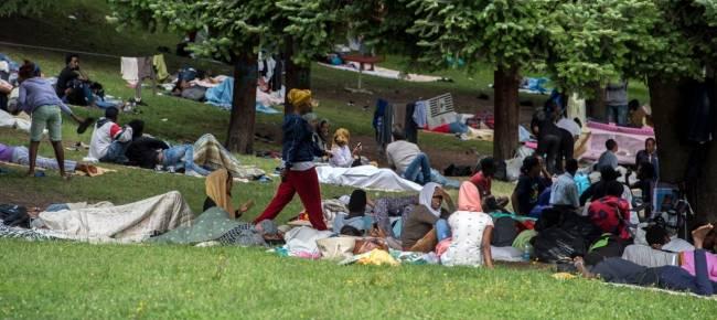 migranti como nuove foto