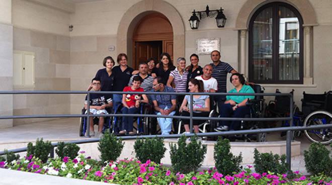 progetto per casa accoglienza di unitalsi a Milano generico unitalsi logo e casa
