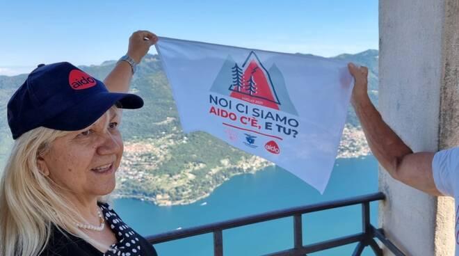 bandiera aido provinciale con presidente al faro voltiano questa mattina